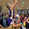 Holy Family's Micaela Blanchard shoots the ball over Peak to Peak's Katharine Kia during Friday's girls game at Peak to Peak.<br /> January 25, 2013<br /> staff photo/ David R. Jennings