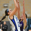 Peak to Peak's Ivy DeVries shoots the ball against Holy Family's Claudia Pena during Friday's girls game at Peak to Peak.<br /> January 25, 2013<br /> staff photo/ David R. Jennings