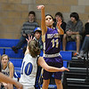 Holy Family's Lindsey Chavez shoots to the basket over Peak to Peak's Katherine Kia during Friday's girls game at Peak to Peak.<br /> January 25, 2013<br /> staff photo/ David R. Jennings