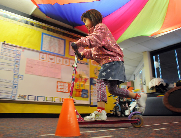 Ramona Allen-Bruno rides a scooter through a course during Pee Wee Circus at Mountain View Elementary School on Friday. <br /> <br /> <br /> March 18, 2010<br /> Staff photo/David R. Jennings