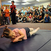 Miryah Bonney performs her stunt with the Pretzel Family Troupe during the Pee Wee Circus at Mountain View Elementary School on Friday. <br /> <br /> <br /> March 18, 2010<br /> Staff photo/David R. Jennings
