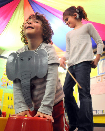 Carson Wagner is an elephant with his trainer Reese Mansur during the Pee Wee Circus at Mountain View Elementary School on Friday. <br /> <br /> <br /> March 18, 2010<br /> Staff photo/David R. Jennings