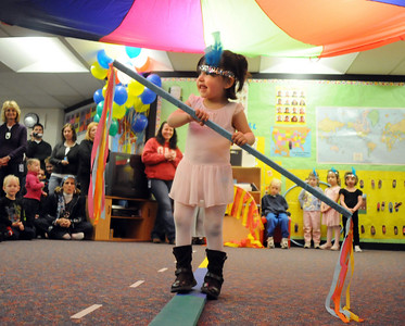 Samantha Montoya uses a stick to balance for her high wire act during the deaf and hard of hearing preschool/kindergarten's Pee Wee Circus at Mountain View Elementary School on Friday. The combined morning and afternoon students 3-6 years old performed animal, high wire, and other acts for parents in the classroom.    March 18, 2010 Staff photo/David R. Jennings