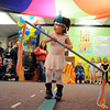 Samantha Montoya uses a stick to balance for her high wire act during the deaf and hard of hearing preschool/kindergarten's Pee Wee Circus at Mountain View Elementary School on Friday. The combined morning and afternoon students 3-6 years old performed animal, high wire, and other acts for parents in the classroom. <br /> <br /> <br /> March 18, 2010<br /> Staff photo/David R. Jennings