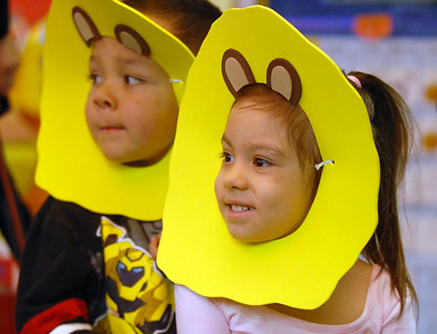 Ivan Arridga-Rodgriguez, left, and Alyssa Moulin, dressed as lions,  arrive riding wagons for the Pee Wee Circus at Mountain View Elementary School on Friday.   March 18, 2010 Staff photo/David R. Jennings