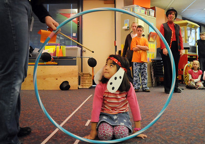"""Ramona Allen-Bruno, dressed as a dog, waits for encouragment from the crowd  and her """"trainer"""" teacher Jeannene Evenstad, to jump through the hoop during Pee Wee Circus at Mountain View Elementary School on Friday.   March 18, 2010 Staff photo/David R. Jennings"""