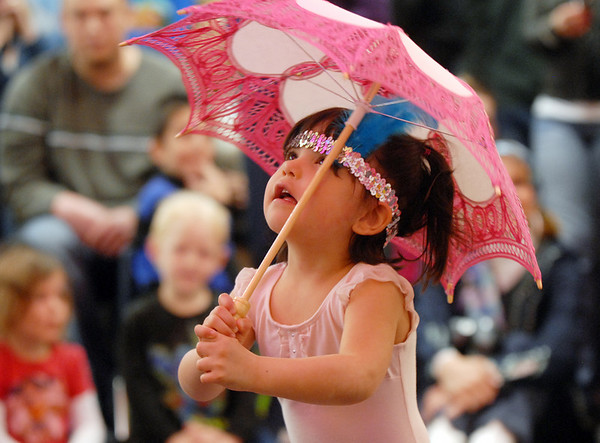 Samantha Montoya looks at the umbrella during her high wire act during the deaf and hard of hearing preschool/kindergarten's Pee Wee Circus at Mountain View Elementary School on Friday.<br /> <br /> <br /> March 18, 2010<br /> Staff photo/David R. Jennings