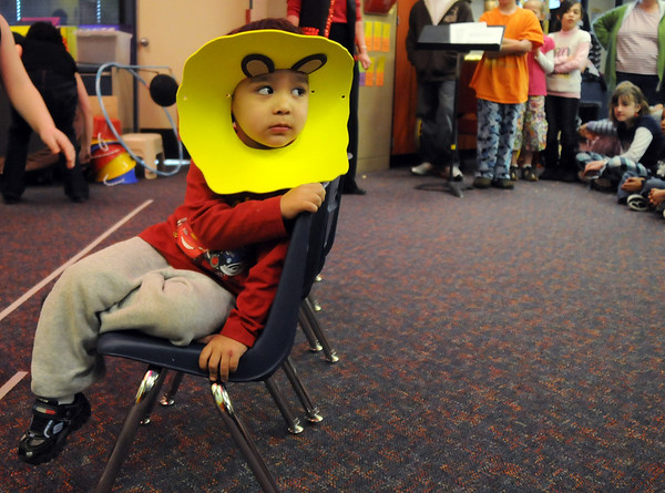 Cesar Palafax, dressed as a lion, looks at the crowd during the Pee Wee Circus by the deaf and hard of hearing preschool/kindergarten at Mountain View Elementary School on Friday. The combined morning and afternoon students 3-6 years old performed animal, high wire, and other acts for parents in the classroom. <br /> <br /> <br /> March 18, 2010<br /> Staff photo/David R. Jennings