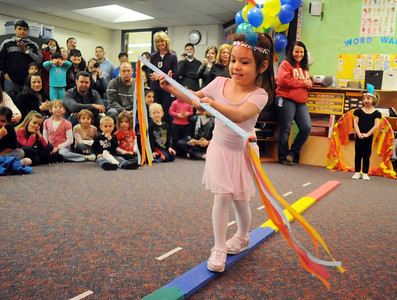 Alyssa Moulin uses a stick to balance for her high wire act during the deaf and hard of hearing preschool/kindergarten's Pee Wee Circus at Mountain View Elementary School on Friday. The combined morning and afternoon students 3-6 years old performed animal, high wire, and other acts for parents in the classroom.    March 18, 2010 Staff photo/David R. Jennings