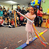 Alyssa Moulin uses a stick to balance for her high wire act during the deaf and hard of hearing preschool/kindergarten's Pee Wee Circus at Mountain View Elementary School on Friday. The combined morning and afternoon students 3-6 years old performed animal, high wire, and other acts for parents in the classroom. <br /> <br /> <br /> March 18, 2010<br /> Staff photo/David R. Jennings