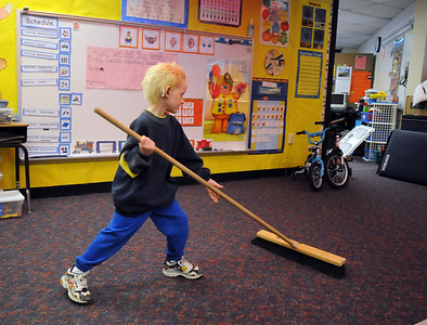 """Tyler Ansell sweeps up after the """"animal"""" acts during the Pee Wee Circus at Mountain View Elementary School on Friday.    March 18, 2010 Staff photo/David R. Jennings"""