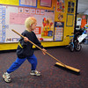 "Tyler Ansell sweeps up after the ""animal"" acts during the Pee Wee Circus at Mountain View Elementary School on Friday. <br /> <br /> <br /> March 18, 2010<br /> Staff photo/David R. Jennings"