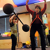Kaylie Bookout, as the strong girl, is encouraged by her teacher Dianne Goberis to lift the heavy weights during the Pee Wee Circus at Mountain View Elementary School on Friday. <br /> <br /> March 18, 2010<br /> Staff photo/David R. Jennings