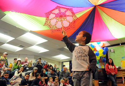 Marat Kempf holds an umbrella while preforming his high wire act during the deaf and hard of hearing preschool/kindergarten's Pee Wee Circus at Mountain View Elementary School on Friday. The combined morning and afternoon students 3-6 years old performed animal, high wire, and other acts for parents in the classroom. The students worked for 3 weeks on the circus.   March 18, 2010 Staff photo/David R. Jennings
