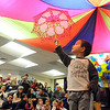 Marat Kempf holds an umbrella while preforming his high wire act during the deaf and hard of hearing preschool/kindergarten's Pee Wee Circus at Mountain View Elementary School on Friday. The combined morning and afternoon students 3-6 years old performed animal, high wire, and other acts for parents in the classroom. The students worked for 3 weeks on the circus.<br /> <br /> <br /> March 18, 2010<br /> Staff photo/David R. Jennings