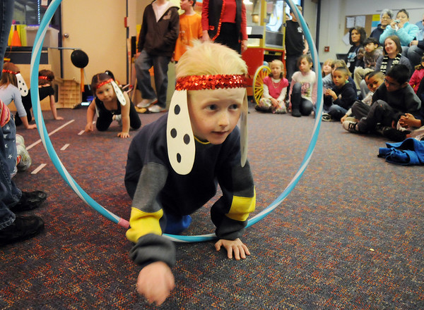 "Tyler Ansell, dressed as a dog, ""jumps"" through a hoop during the Pee Wee Circus by the deaf and hard of hearing preschool/kindergarten at Mountain View Elementary School on Friday. The combined morning and afternoon students 3-6 years old performed animal, high wire, and other acts for parents in the classroom. <br /> <br /> <br /> March 18, 2010<br /> Staff photo/David R. Jennings"