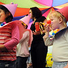 Ramona Allen-Bruno, left, and Courtney Ansell dressed as clowns for the finale of the Pee Wee Circus by the deaf and hard of hearing preschool/kindergarten at Mountain View Elementary School on Friday. The combined morning and afternoon students 3-6 years old performed animal, high wire, and other acts for parents in the classroom. <br /> <br /> <br /> <br /> March 18, 2010<br /> Staff photo/David R. Jennings