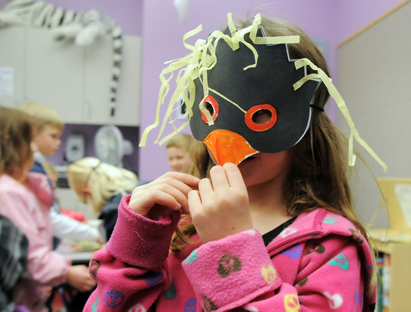 Joleen Jacobi, 6, wears her penguin mask during Third Saturday Fun's Penguin Adventure at the Children's Library at Mamie Doud Eisenhower Public Library on Saturday. <br /> <br /> January 15, 2011<br /> staff photo/David R. Jennings