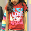 Kaviya Chidambaram, 6, tries to walk like a penguin during Third Saturday Fun's Penguin Adventure at the Children's Library at Mamie Doud Eisenhower Public Library on Saturday.  <br /> <br /> January 15, 2011<br /> staff photo/David R. Jennings