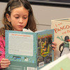 Joleen Jacobi, 6, reads a book about penguins during Third Saturday Fun's Penguin Adventure at the Children's Library at Mamie Doud Eisenhower Public Library on Saturday.  <br /> <br /> January 15, 2011<br /> staff photo/David R. Jennings