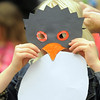 BE0120penguin14<br /> Emma Alford, 6, tries on her penguin mask during Third Saturday Fun's Penguin Adventure at the Children's Library at Mamie Doud Eisenhower Public Library on Saturday.  <br /> <br /> January 15, 2011<br /> staff photo/David R. Jennings