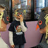 Beau Noland, 7, left, and Maks Marko, 6, right, with Caleb Ellis, 7, center, looks at each other's penguin masks during Third Saturday Fun's Penguin Adventure at the Children's Library at Mamie Doud Eisenhower Public Library on Saturday.  <br /> <br /> January 15, 2011<br /> staff photo/David R. Jennings