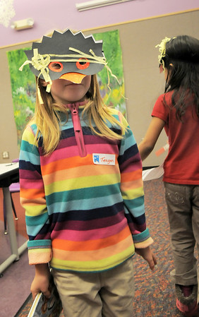 Teagan Bradley, 6, tries to walk like a penguin while wearing the mask  she made during Third Saturday Fun's Penguin Adventure at the Children's Library at Mamie Doud Eisenhower Public Library on Saturday. <br /> <br /> January 15, 2011<br /> staff photo/David R. Jennings
