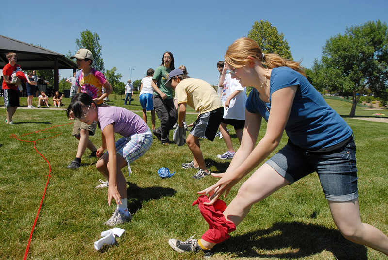 "BE0704SWORD10<br /> Rebekah George, 15, right, and fellow ""camp"" members scramble to toss clothing items to their opponent's side  during a game at the Percy Jackson and Camp Half-Blood Mamie Doud Eisenhower Public Library program on Wednesday at Community Park.<br /> <br /> June 30, 2010<br /> Staff photo/ David R. Jennings"