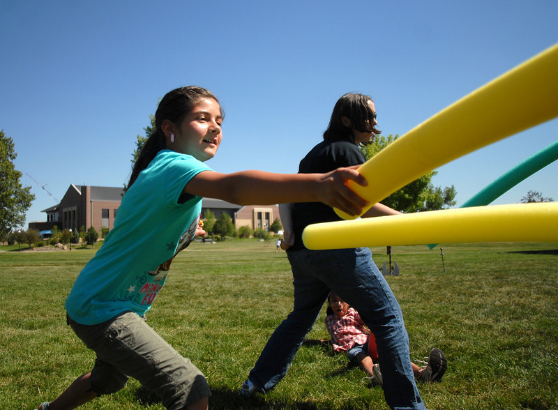 BE0704SWORD01<br /> Vanessa Cornejo, 10, learns to use a foam sword during the sword fighting session at the Percy Jackson and Camp Half-Blood Mamie Doud Eisenhower Public Library program on Wednesday at Community Park.<br /> <br /> June 30, 2010<br /> Staff photo/ David R. Jennings