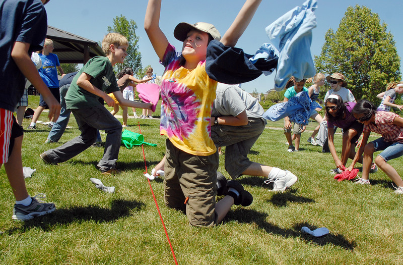 BE0704SWORD11<br /> Parker Loertscher, 11, right, tries to catch clothing items being thrown during a game at the Percy Jackson and Camp Half-Blood Mamie Doud Eisenhower Public Library program on Wednesday at Community Park.<br /> <br /> <br /> June 30, 2010<br /> Staff photo/ David R. Jennings