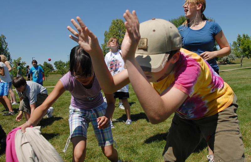 BE0704SWORD07<br /> Parker Loertscher, 11, right, tries to dodge clothing items being thrown during a game at the Percy Jackson and Camp Half-Blood Mamie Doud Eisenhower Public Library program on Wednesday at Community Park.<br /> <br /> June 30, 2010<br /> Staff photo/ David R. Jennings