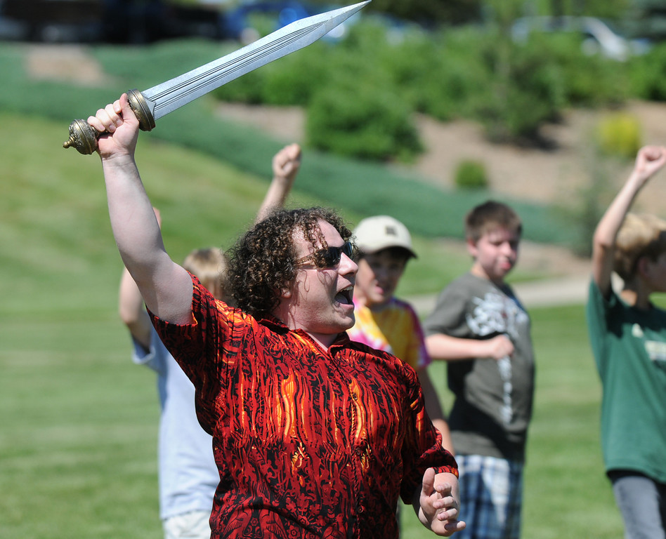 BE0704SWORD05<br /> Seth Maisel, stage fighting expert,  gives students instructions on blocking blows while sword fighting during the Percy Jackson and Camp Half-Blood Mamie Doud eisenhower Public Library program on Wednesday at Community Park.<br /> <br /> June 30, 2010<br /> Staff photo/ David R. Jennings