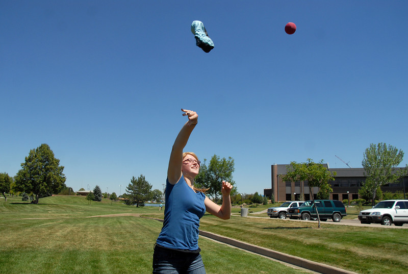 BE0704SWORD09<br /> Rebekah George, 15, tosses a shoe and a ball during a game at the Percy Jackson and Camp Half-Blood Mamie Doud Eisenhower Public Library program on Wednesday at Community Park.<br /> <br /> June 30, 2010<br /> Staff photo/ David R. Jennings