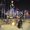 "Alessadro Lauria, 11,  stands on playground equipment with dogs Cedar, left, and Lucy while listening to the pet remembrance ceremony on Friday at the Girl Scout Shelter in Midway Park in Broomfield.<br /> <br /> More photos please see  <a href=""http://www.broomfieldenterprise.com"">http://www.broomfieldenterprise.com</a><br /> December 30, 2011<br /> staff photo/ David R. Jennings"
