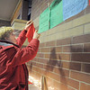 "Tina Lynn Craig puts up a prayer flag to honor the memory of her dog Chester during the pet remembrance ceremony on Friday at the Girl Scout Shelter in Midway Park in Broomfield.<br /> <br /> More photos please see  <a href=""http://www.broomfieldenterprise.com"">http://www.broomfieldenterprise.com</a><br /> December 30, 2011<br /> staff photo/ David R. Jennings"