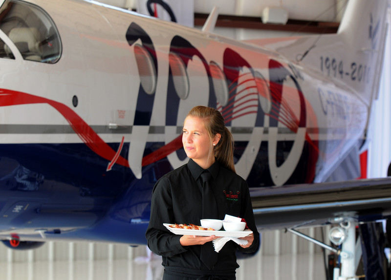 Elizabeth Farrell with Three Tomatos wait to serve people during the celebration of the 1000th PC-12 NG aircraft at Pilatus Aircraft's western hemisphere headquarters based at Rocky Mountain Metropolitan Airport in Broomfield on Thursday<br /> July 15, 2010<br /> Staff photo/ David R. Jennings