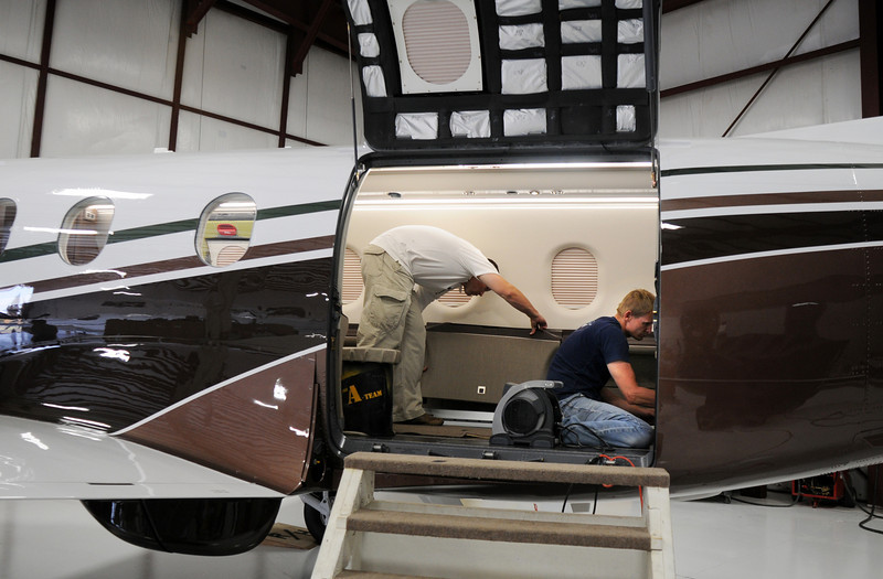 Pilatus employees Shannon Nickel, left, and David Brown work on the interior of a PC-12 NG before the celebration of the 1000th PC-12 NG aircraft at Pilatus Aircraft's western hemisphere headquarters based at Rocky Mountain Metropolitan Airport in Broomfield on Thursday<br /> July 15, 2010<br /> Staff photo/ David R. Jennings