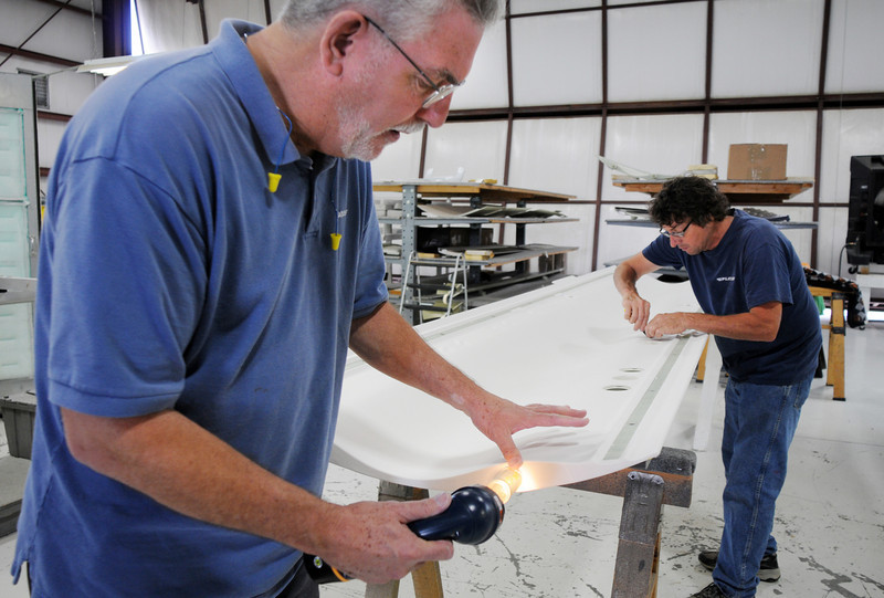 Pilatus employees Keith Cox, left, and Ron Blair work on an interior panel for a PC-12 NG before the celebration of the 1000th PC-12 NG aircraft at Pilatus Aircraft's western hemisphere headquarters based at Rocky Mountain Metropolitan Airport in Broomfield on Thursday<br /> July 15, 2010<br /> Staff photo/ David R. Jennings