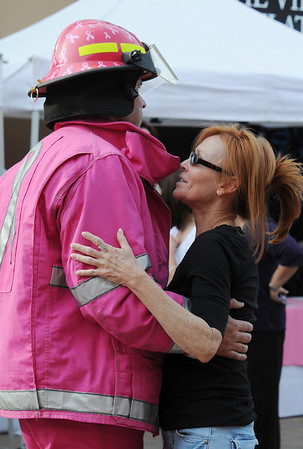 Jo Johnson from Columbus, Ohio, right, dances with Dave Graybill during the Pink Heals Tour stop at the Village at FlatIron Crossing on Tuesday.<br /> Sept. 15, 2009<br /> Staff photo/David R. Jennings