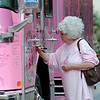Linda Jo Danielson, of Arvada,  signs one of the Pink Fire Trucks during the Pink Heals Tour stop at the Village at FlatIron Crossing on Tuesday.<br /> Sept. 15, 2009<br /> Staff photo/David R. Jennings