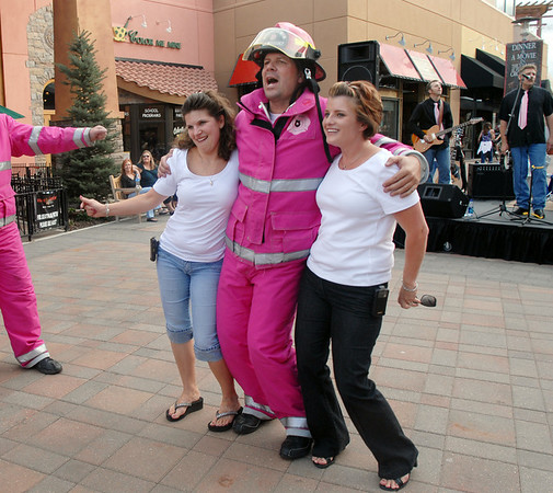 Shawnda Bauer, left and Kristin Rodgriguez, right, dance with Dave Graybill to the music of Circle of Willis during the Pink Heals Tour stop at the Village at FlatIron Crossing on Tuesday.<br /> Sept. 15, 2009<br /> Staff photo/David R. Jennings