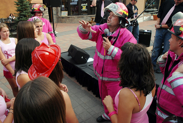 Dave Graybill, right,  head of the Pink Heals Tour, speaks to participants during the event at the Village at FlatIron Crossing on Tuesday.<br /> Sept. 15, 2009<br /> Staff photo/David R. Jennings
