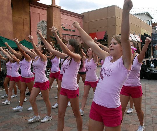 Legacy High cheerleaders perform a cheer during the Pink Heals Tour  stop at the Village at FlatIron Crossing on Tuesday.<br /> Sept. 15, 2009<br /> Staff photo/David R. Jennings