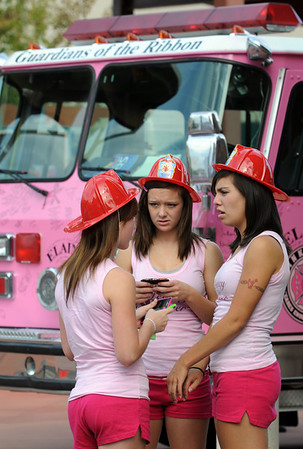 Legacy High cheerleaders Chelsea Beamer, left, Alex VanDeboogaard and D'Niece Martinez chat in front of one of the Pink Fire Truck during the Pink Heals Tour stop at the Village at FlatIron Crossing on Tuesday.<br /> Sept. 15, 2009<br /> Staff photo/David R. Jennings