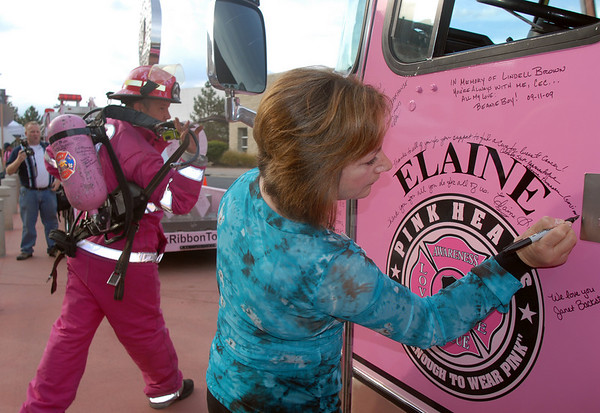 Colorado State Representative Dianne Primavera signs a Pink Fire Truck during the Pink Heals Tour stop at the Village at FlatIron Crossing on Tuesday.<br /> Sept. 15, 2009<br /> Staff photo/David R. Jennings