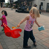 Summer Drew, 4, right, and her sister Piper, 2, dance to the music of the band Circle of Willis for the Pink Heals Tour stop at the Village at FlatIron Crossing on Tuesday.<br /> Sept. 15, 2009<br /> Staff photo/David R. Jennings