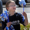 "Rylie James, 9, looks at pinwheels to be ""planted""  in the raised flower bed at Mamie Doud Eisenhower Public Library on Saturday for National Child Abuse Prevention Month.<br /> <br /> April 2, 2011<br /> staff photo/David R. Jennings"