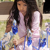 "Kaviya Chidambaram 6,  helps ""plant"" 300 pinwheels in the raised flower bed at Mamie Doud Eisenhower Public Library on Saturday for National Child Abuse Prevention Month.<br /> <br /> April 2, 2011<br /> staff photo/David R. Jennings"
