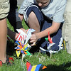 Aspen Creek K-8 eighth grader Zach Turner plants his pinwheel for the Pinwheels for Peace project on Wednesday at the school. Students from all grades planted pinwheels in the shape of peace signs.<br /> September 21, 2011<br /> staff photo/ David R. Jennings