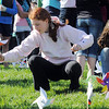 Aspen Creek K-8 eighth graders Taylor Lindquist, left, and Madi Clements plant pinwheels for the Pinwheels for Peace project on Wednesday at the school. Students from all grades planted pinwheels making the shape of peace signs.<br /> September 21, 2011<br /> staff photo/ David R. Jennings
